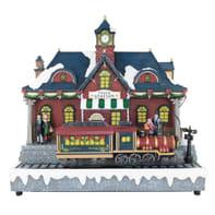Villaggio di natale animato con treno e stazione